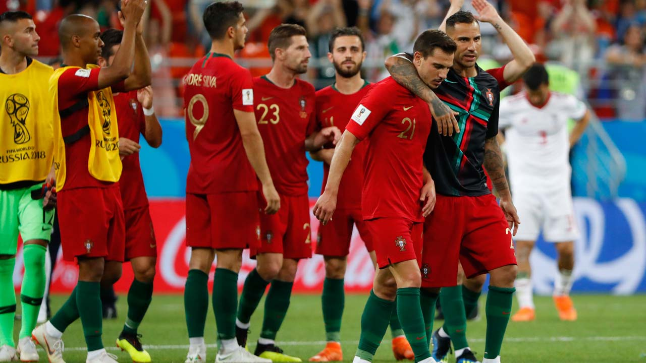 Portugal s forward Ricardo Quaresma (R) speaks with Portugal s defender  Cedric Soares during the Russia 2018 World Cup Group B football match  between Iran ... 8a02f750b