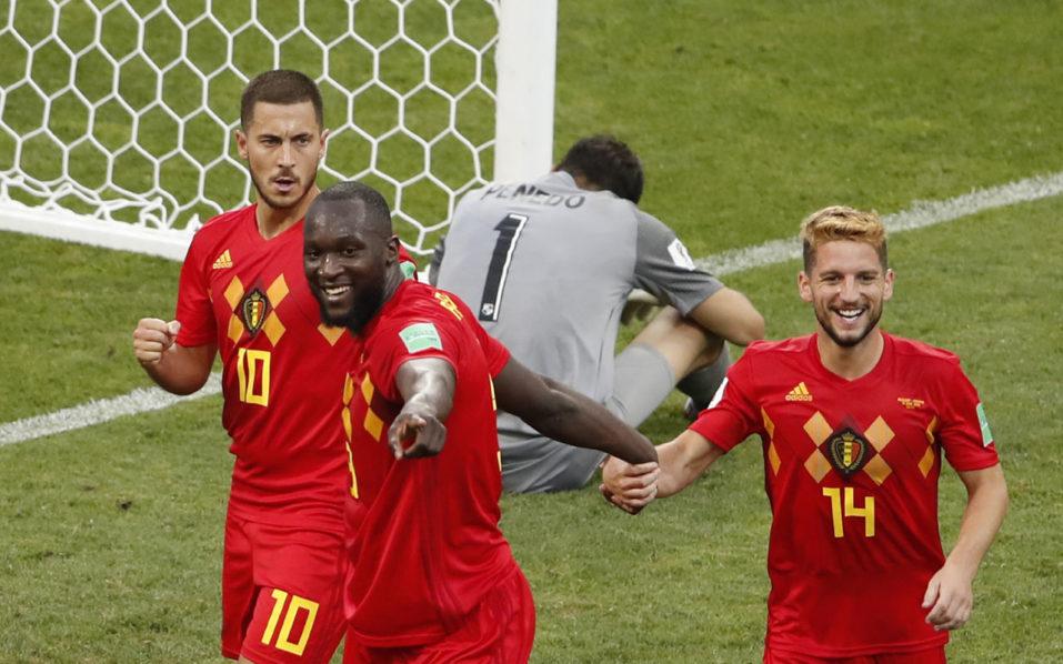 b05c578aa1a Belgium s forward Romelu Lukaku (2nd-L) celebrates his first goal