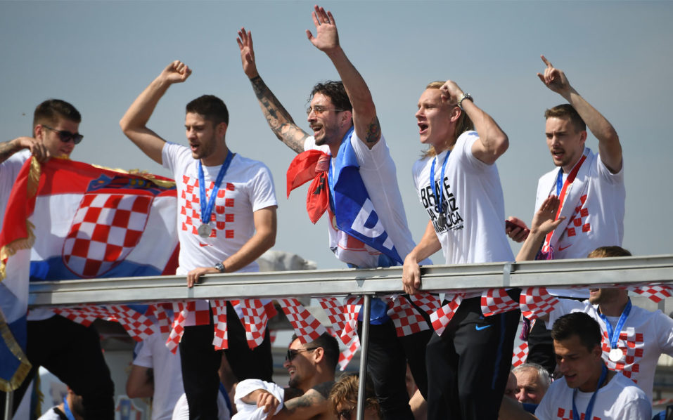 cdf545e06 Croatian national football team members ride an open-roof coach in Zagreb  International Airport on July 16