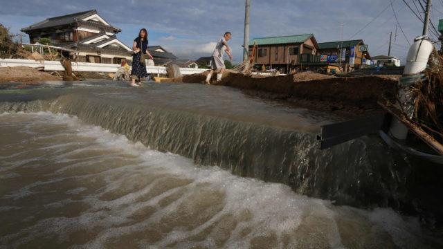 Landslide warnings as Japan digs through rain devastation