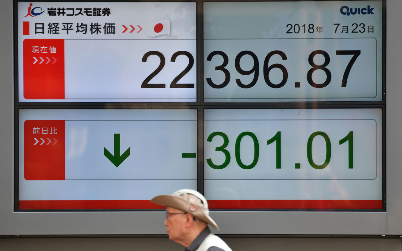 Tokyo shares edge higher as dollar climbs