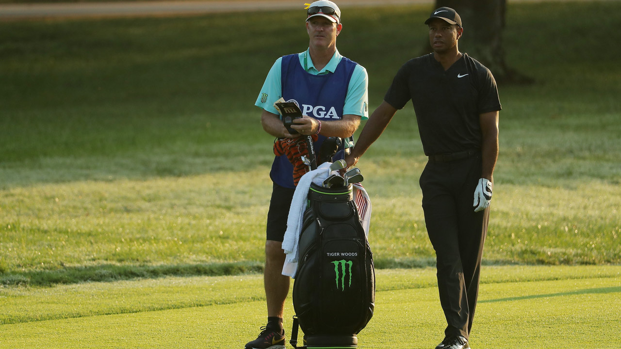 Storm-hit PGA resumes with Tiger chasing leader Woodland