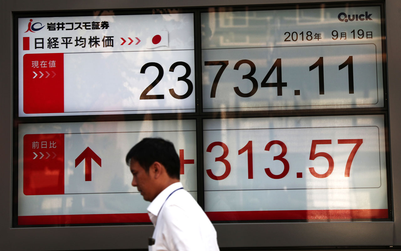 Tokyo shares jump on US-China trade talks, easing Brexit fears