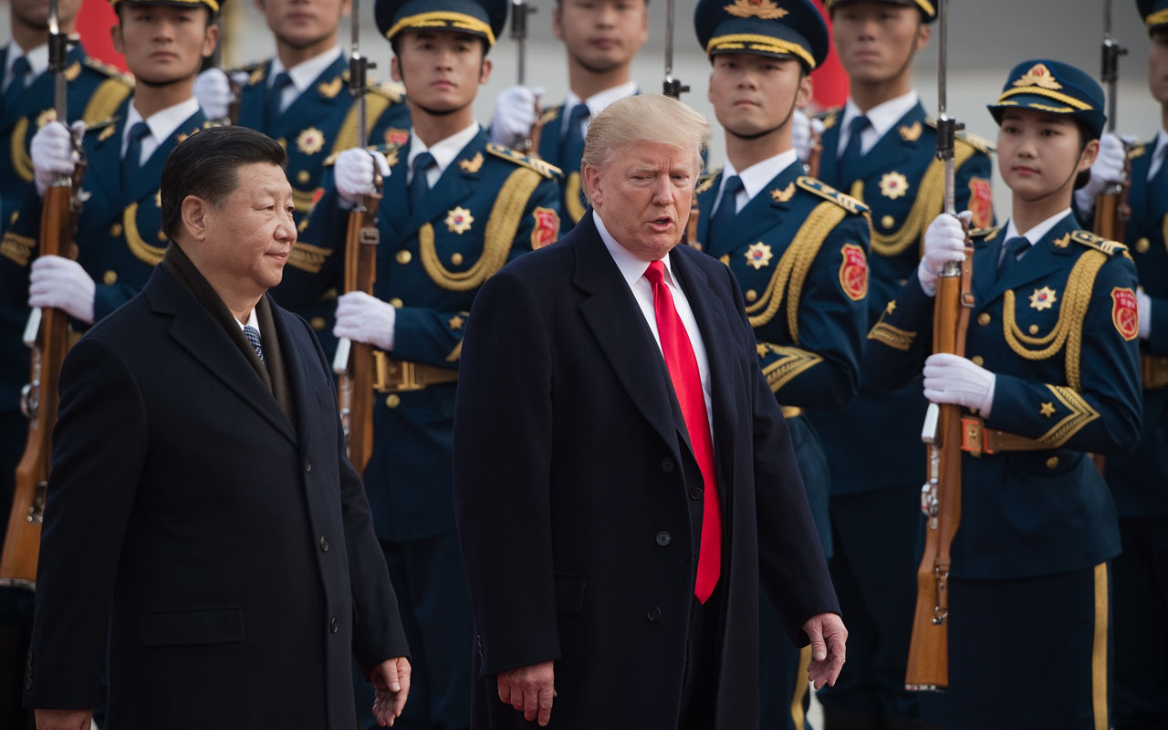 China accuses Trump of 'holding a knife to its throat' with tariffs