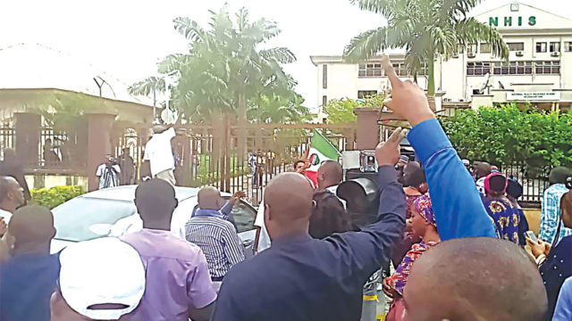 Police storm NHIS office, teargas staff, reinstate Yusuf