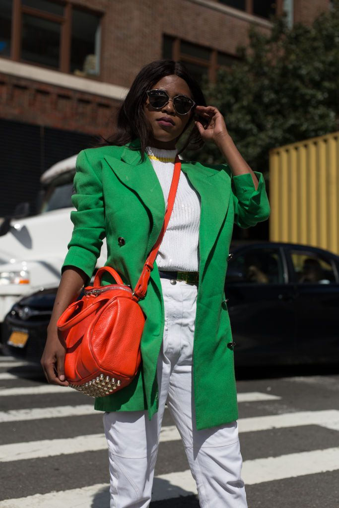 A lady wearing a green oversized blazer