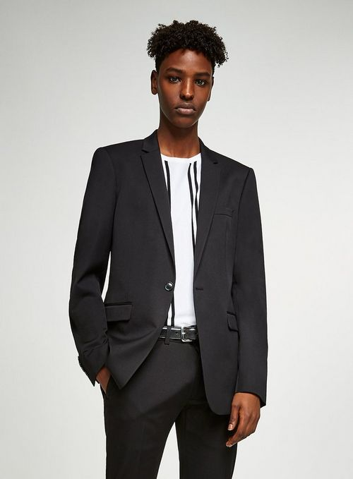 A male model wearing a black oversized blazer