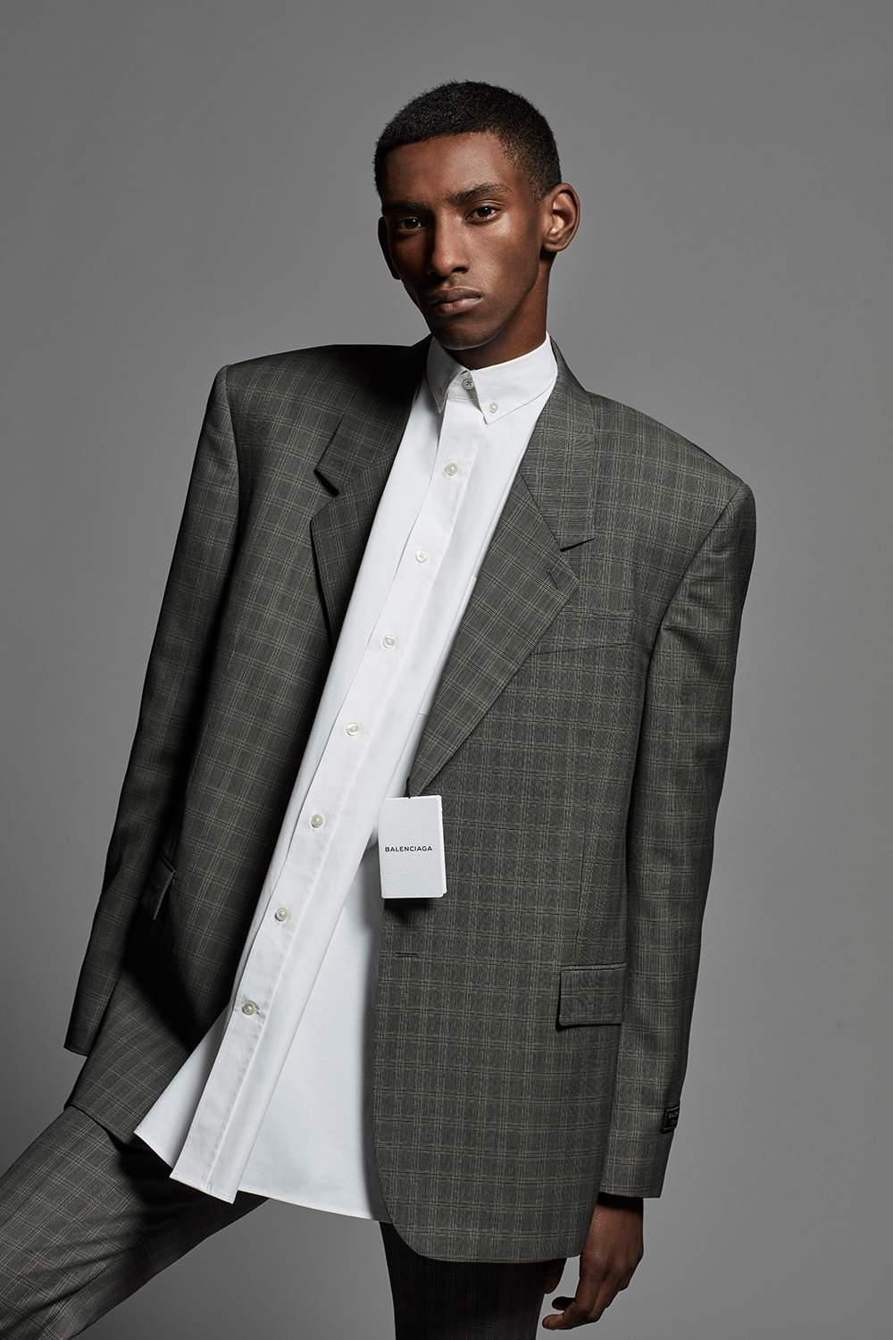 A male model wearing a patterned oversized blazer