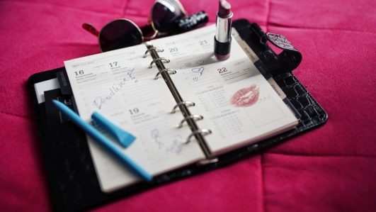 A woman's 2019 calendar with lipstick stain