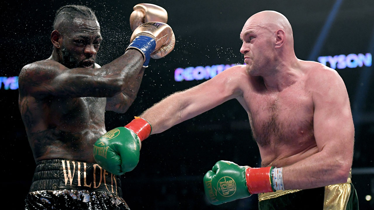 Wilder, Fury battle to draw in heavyweight thriller