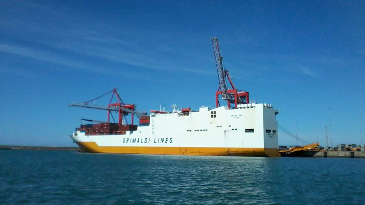 Four men charged following 'stowaway threats' aboard Grande Tema