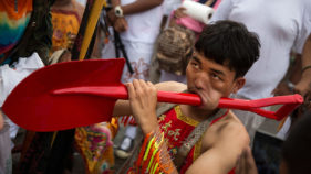 A man celebrating Phuket Vegetarian Festival