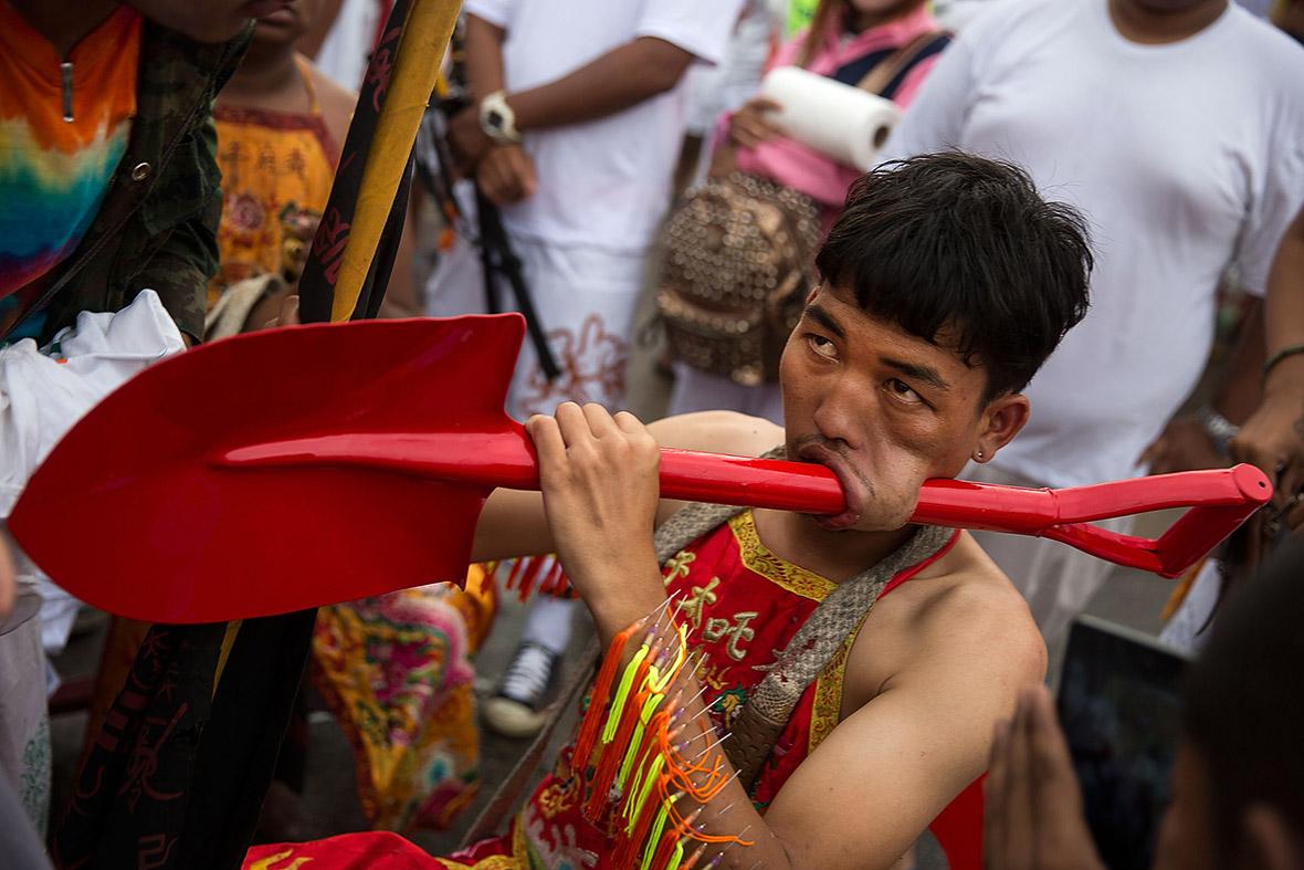 A man celebrating Phuket Vegetarian Festival