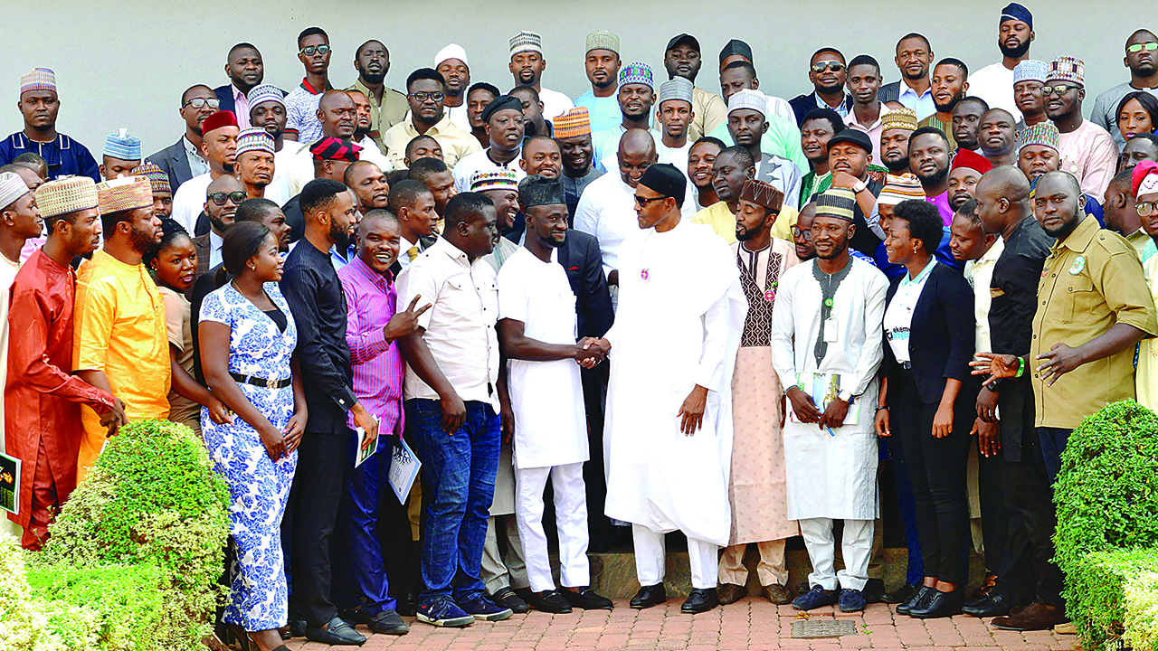 President Muhammadu Buhari (6th R), President of National Association of Nigerian Students (NANS), Bamidele Akpan (7th L). Photo: Guardian