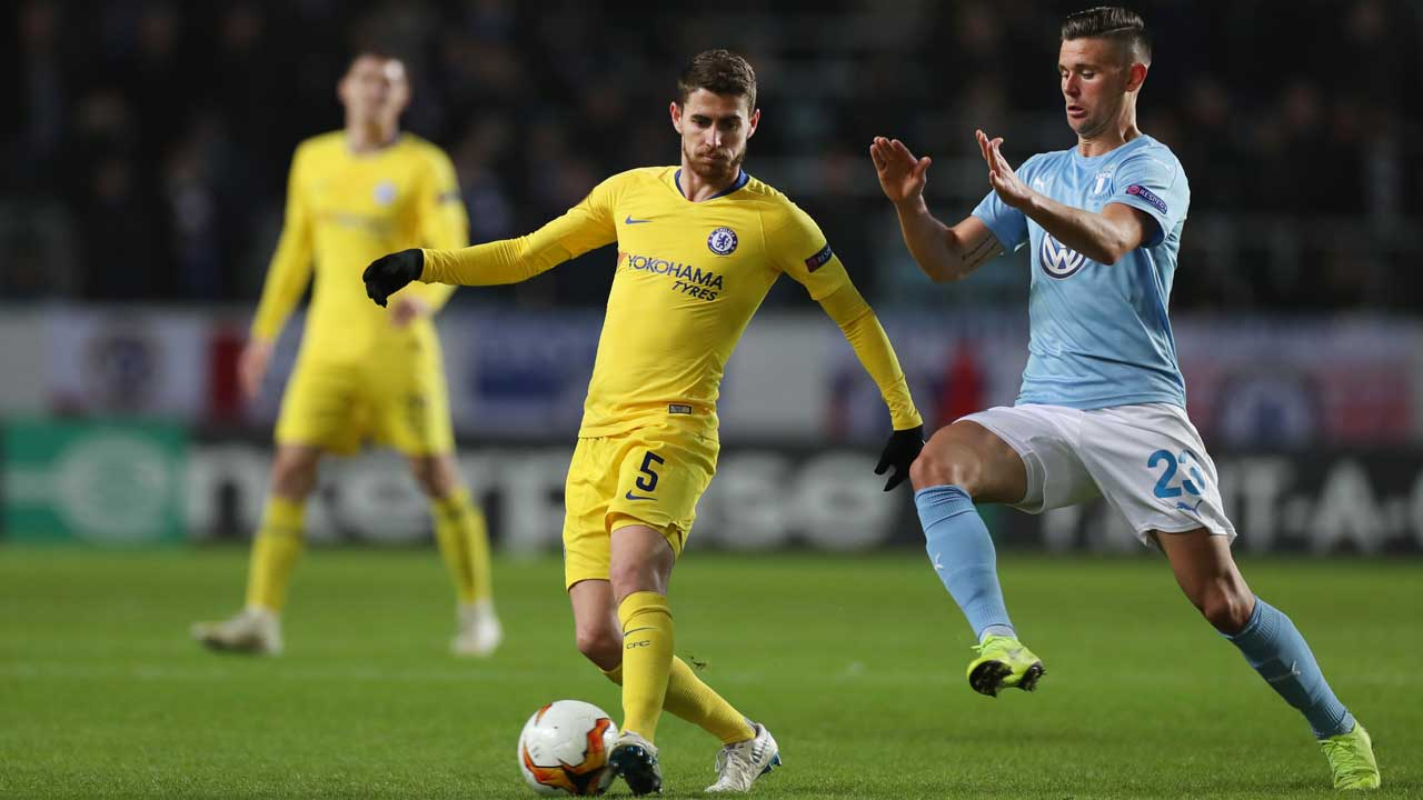 c68ec319dc0 Chelsea s Italian midfielder Jorginho and Malmo s Marcus Antonsson vie for  the ball during the UEFA Europa League round of 32