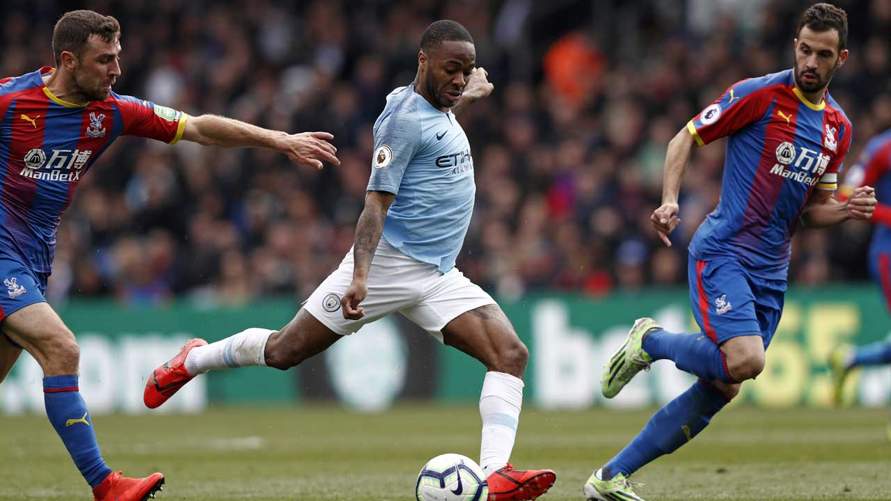 Sterling double takes Man City top once more