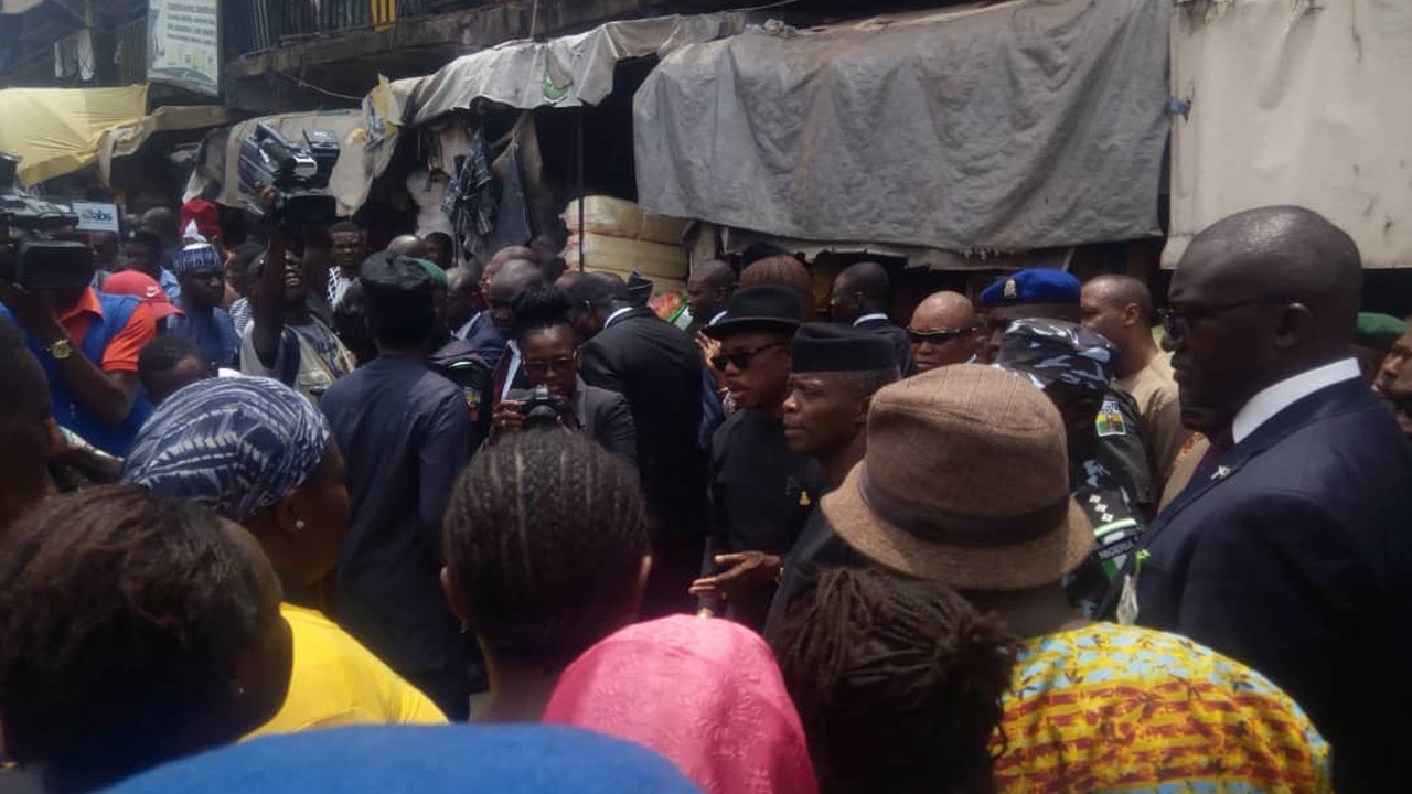 Image: Vice President, Yemi Osinbajo engages with traders in Eke Awka.