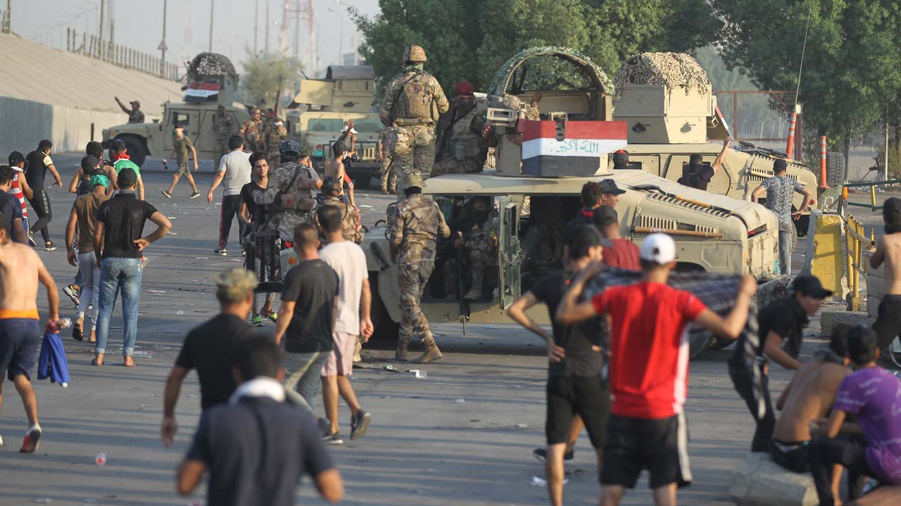 Iraqi PM addresses the nation, urges protesters to go home