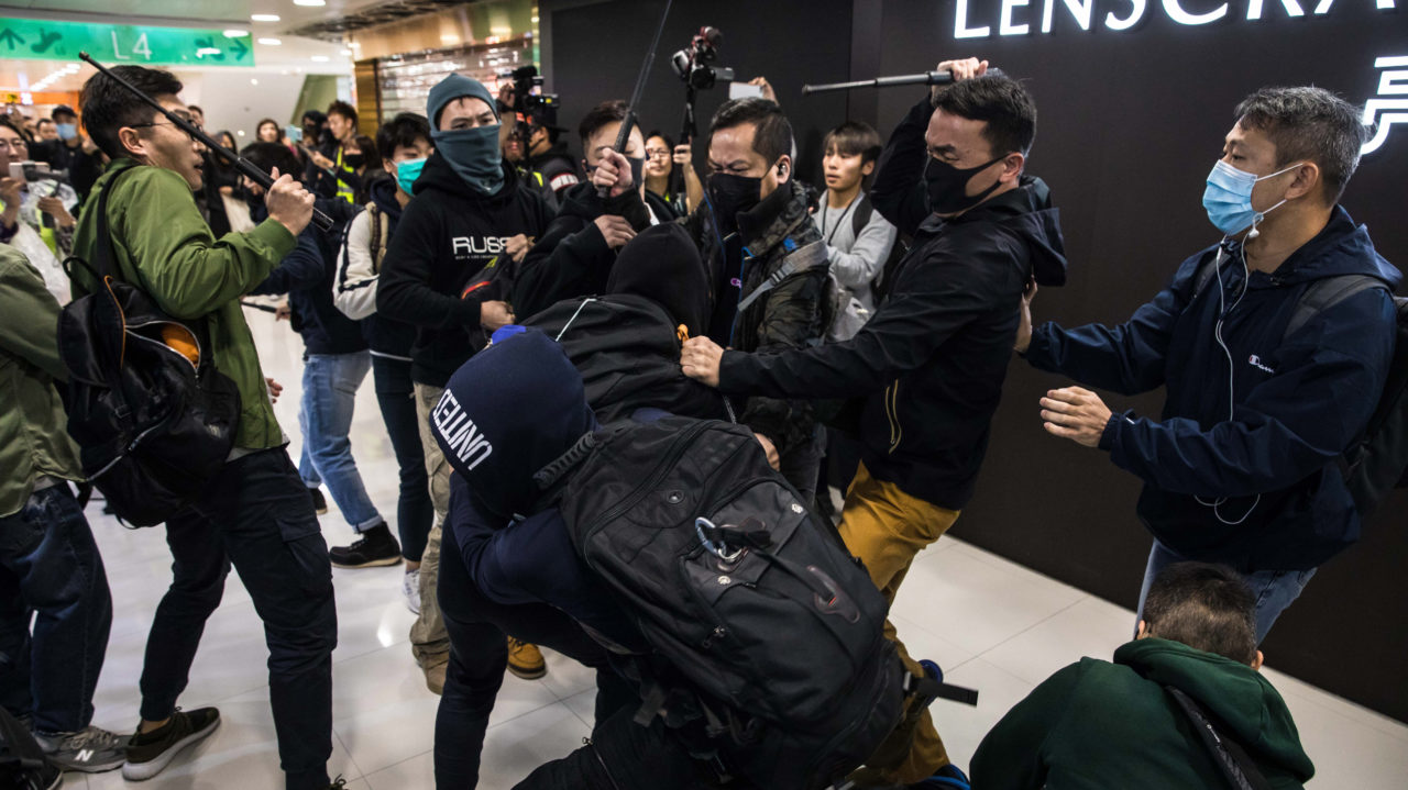 Hong Kong police arrest 15 in fresh shopping mall protests
