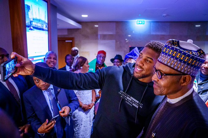 Joshua presents belts to Buhari in UK