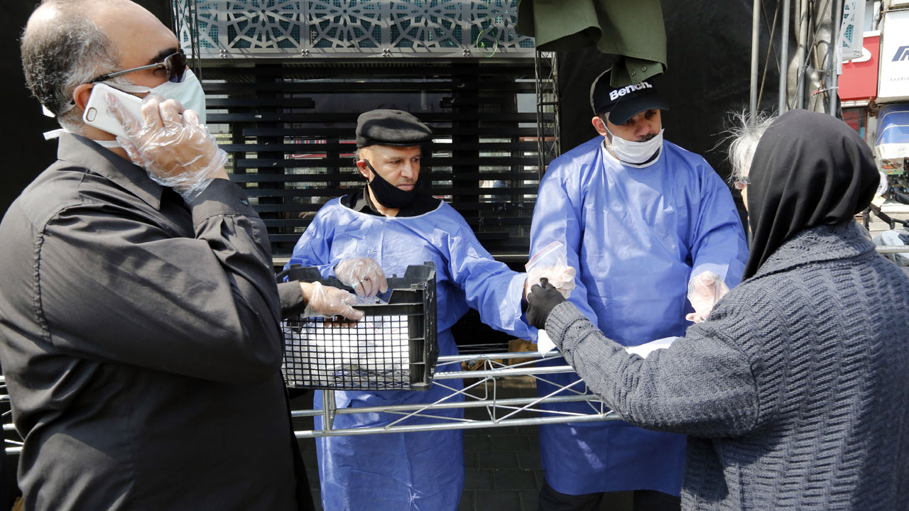 Iran death toll from virus climbs to 988
