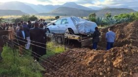 Man buried in his car
