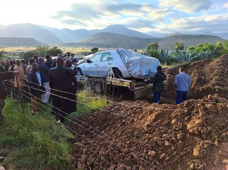 Man buried in his car