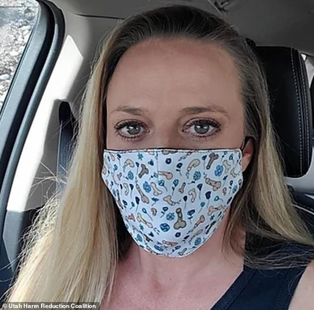 Mindy Vincent wearing a penis face mask