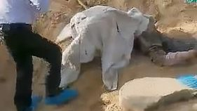 Paralysed woman being rescued from grave
