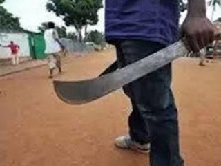 A man holding a machete