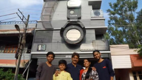 Ravi Hongal and his family in front of their unique home