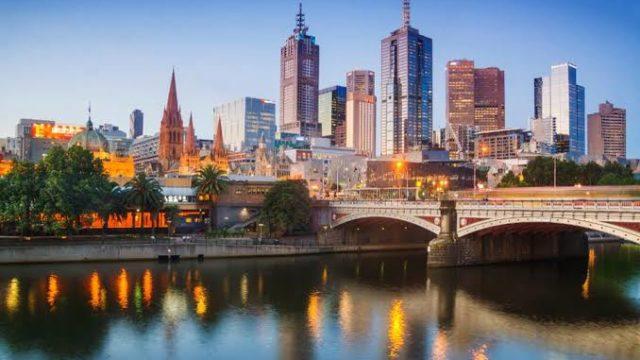 Australia hails vaccine deal as virus surge abates