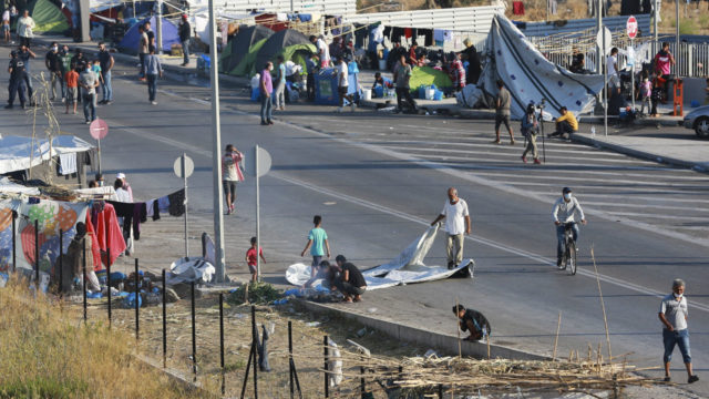 Greek police transfer homeless migrants to new Lesbos camp