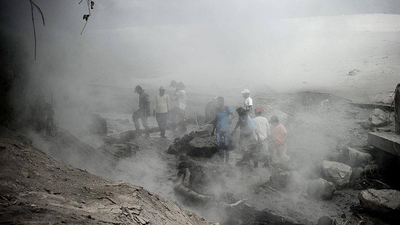 Hundreds flee as Indonesian volcano spews lava and ash