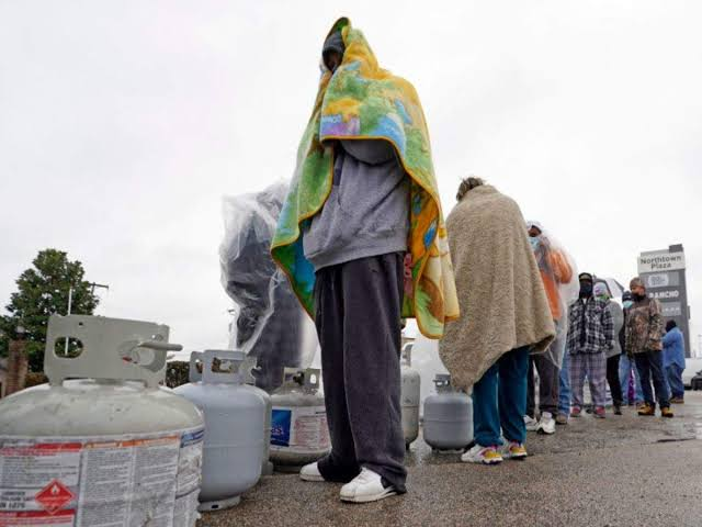 People wait in line to fill his propane tanks Wednesday Feb. 17 2021 in Houston
