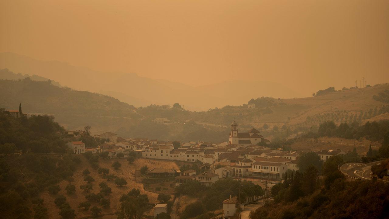 Rain helps fight against 'monster' fire in Spain