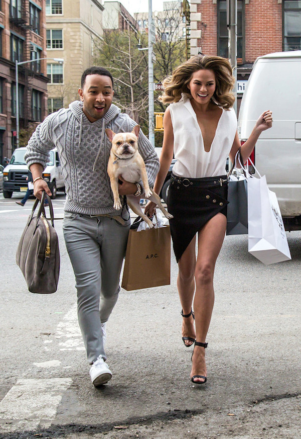 NEW YORK, NY - DECEMBER 01: John Legend and Chrissy Teigen with their dog are seen during a photo shoot in East Village on December 1, 2014 in New York City. (Photo by Alessio Botticelli/GC Images)