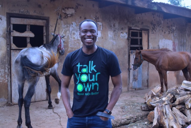 Jake Effudoh rocking the Talk Your Own: Make Naija Better Tee (Image Credit: The Guardian Nigeria)